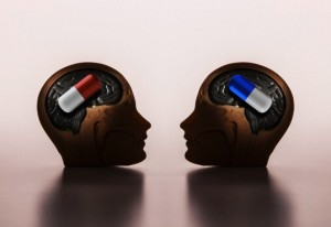 Pills in model heads --- Image by © Jose Luis Pelaez Inc./Image Source/Corbis