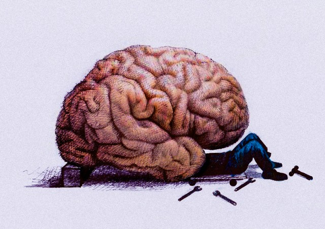12 Mar 2014 --- Mechanic repairing brain --- Image by © Gary Waters/Ikon Images/Corbis