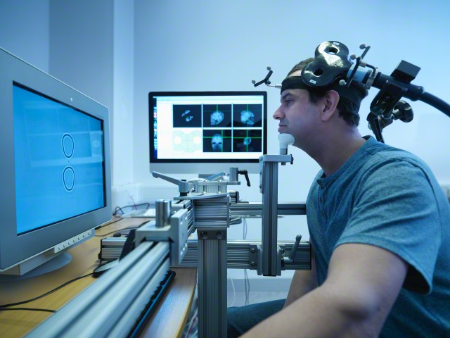 03 Dec 2014 --- Patient in transcranial magnetic stimulation (TMS) experiment --- Image by © Monty Rakusen/Corbis