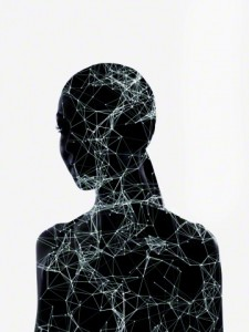 Silhouette of female head and shoulders with digitally generated structure
